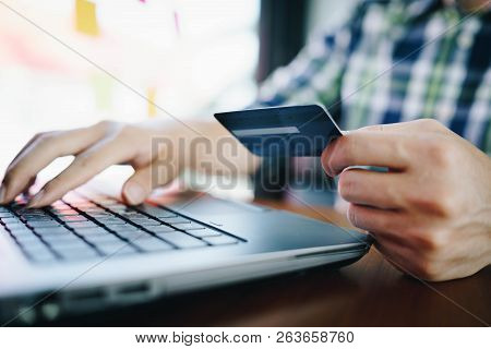 Man With Laptop And Credit Card For Shopping Online. Pays For Purchase.online Shopping, Online Payme