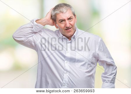 Handsome senior man over isolated background confuse and wonder about question. Uncertain with doubt, thinking with hand on head. Pensive concept.