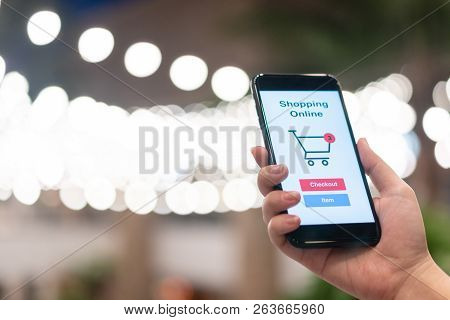 Online Shopping With Smartphone And Shopping Bags Delivery Service Using As Background Shopping Conc