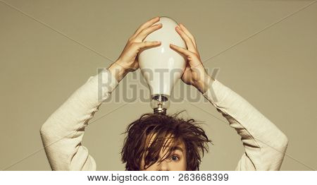 Man With Big Lamp On Head. Guy Has An Idea. Energy And Electricity Concept. Power And Business Succe