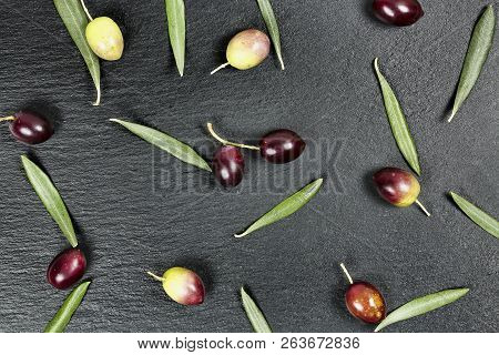 Olives And Leaves On Black Stone Texture