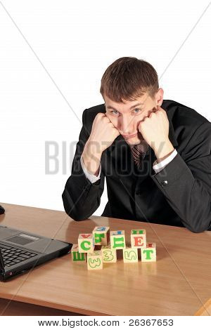 Businessman Try to Compose Blocks With A Letters