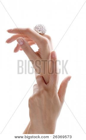 delicate hands with beautiful diamond ring