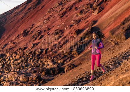 Runner athlete running on mountain trail. Young woman ultra run athlete running fitness workout. Healthy and active lifestyle, strong person jogging outdoor. Health and sport concept.
