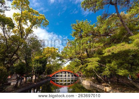 The Japanese traditional drum bridge of Sumiyoshi Taisha temple in the pine tree forest, Osaka, Japan