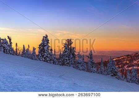 View From The Top Of The Mountain To The Sunset. The Kemerovo Region. Ski Resort Sheregesh. Winter L