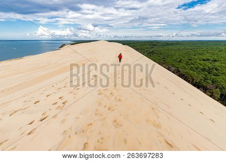 Woman walking at the top of the Pyla (aka Pilat) dune, Arcachon basin, Aquitaine, France