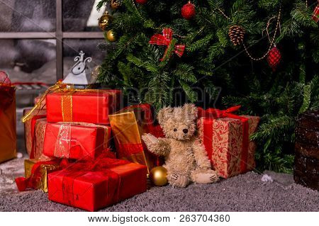 Gifts Under The Christmas Tree, Toy Bear And Boxes, The Concept Of A Cozy Home New Year.bear Waiting