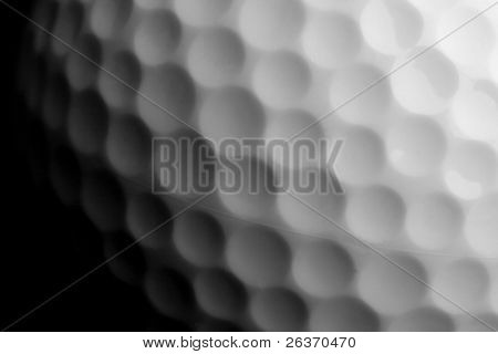 closeup of golf ball isolated on black