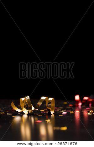 Holiday background; ribbons on black