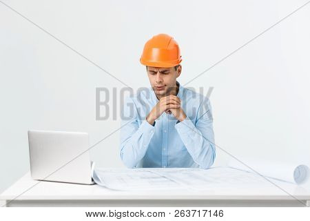 Young workman annoyed angry in furious gesture. Negative expression on white grey background poster