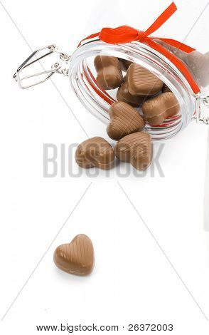 heart shaped candies in a jar
