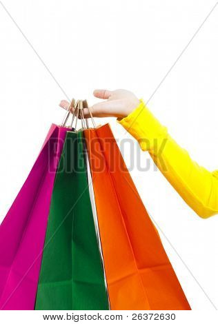 Woman's Hand holding colorful Shopping bags