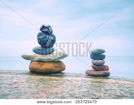 Stack Of Stones On The Sea Beach. Rounded Pebbles Stack In Peaceful Evening With Smooth Ocean Backgr