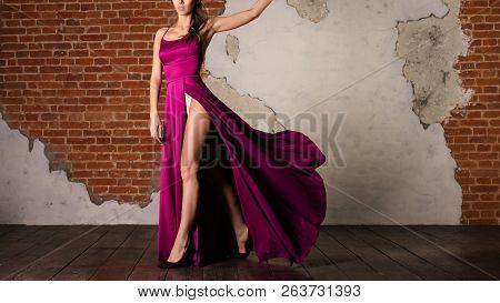Woman In Purple Silk Waving Dress, Girl Artist Dancing In Flowing Cloth On Wind.