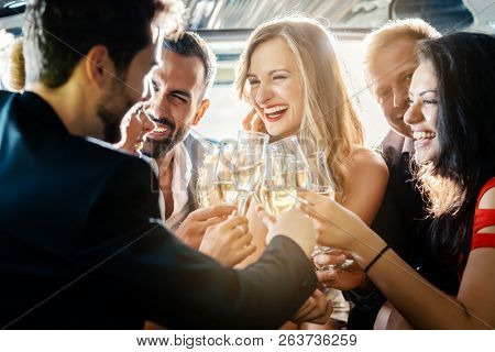 Birthday party in a limo with glasses of champagne