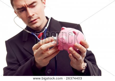 businessman holding piggy bank and stethoscope, finance diagnosis concept