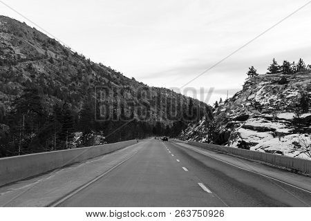 On The Road, In The Sierra Nevada Mountains With Snow On Mountains, Going To South Lake Tahoe, Near