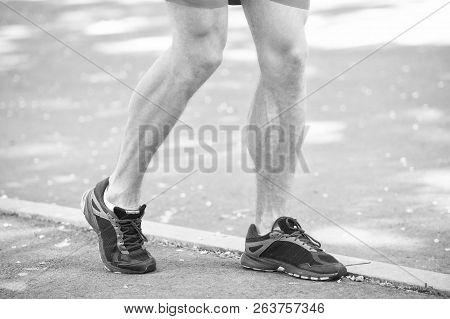 Legs Of Male Athlete Runner Jogging Park Sidewalk. Active Lifestyle Training Cardio Sport Shoes. Vas