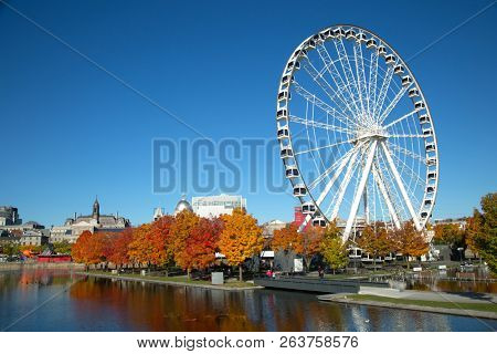 MONTREAL-CANADA, OCTOBER 14, 2018:  Great wheel of Montreal with his panoramic view 60 of meters high, and a breathtaking view of the river, Old Montreal and downtown city during fall season