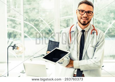 Doctor Working On Tablet Computer In The Hospital.