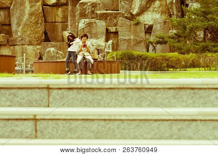 Samcheok, South Korea; September 24, 2018: Young Unidentified Korean Woman, With Her Daughter, Sitti