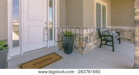 Home With White Front Door And Bench On The Porch