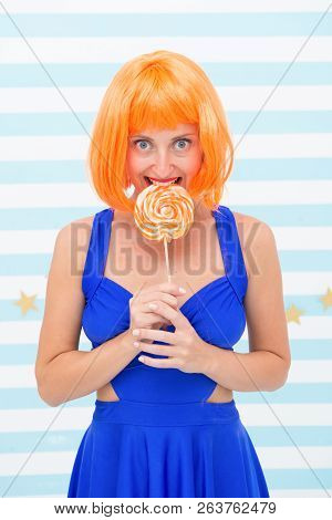 Crazy Girl In Playful Mood. Fashion Girl With Orange Hair Having Fun. Happy Pinup Model With Lollipo