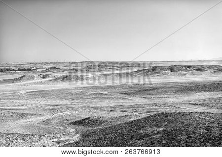 Desert Landscape On Clear Blue Sky Background. Dune Land With Dry Terrain Surface. Ecology And Globa