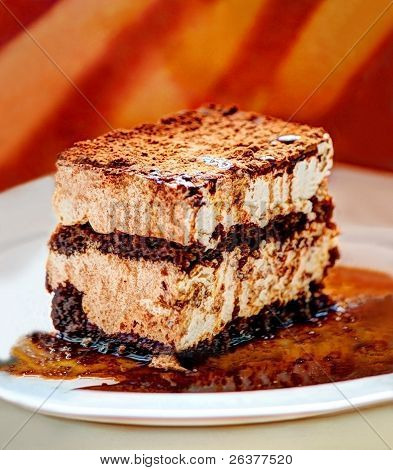 tiramisu cake with brown sauce