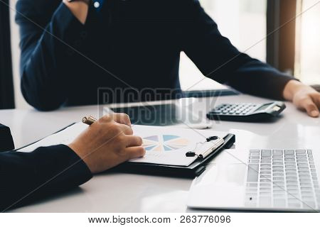 Business People Working Together With Financial Report Discussion Or Investment - Business Financial