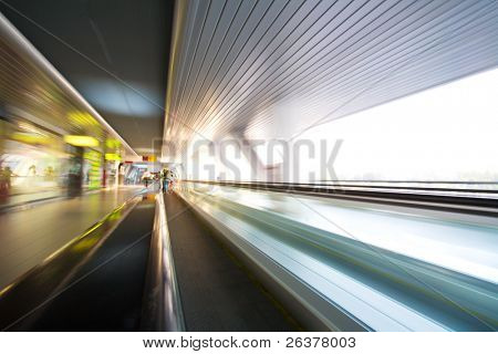 Escalator with motion blur effect in some modern building.