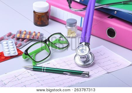 Medical Stethoscope Lying On Cardiogram Chart With Pile Of Pills Closeup. Cardiology Care, Health, P