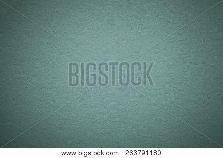 Texture Of Old Dark Green Paper Background, Closeup. Structure Of Dense Light Steel Kraft Cardboard.