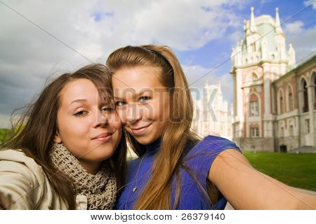 Two young travellers taking pictures of themselves at Moscow landmark Tsaritsino