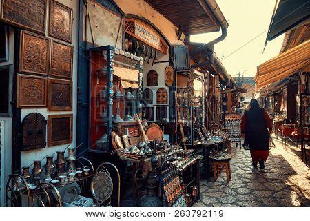 SARAJEVO, BOSNIA AND HERZEGOVINA - JULY 14, 2018: muslim woman walking in Old Sarajevo street bazaar