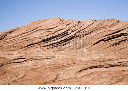 Visible rock stratum - red sandstonein front of blue sky in Arizona USA poster