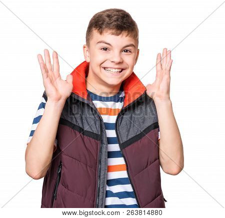 Emotional Portrait Of Caucasian Laughing Happy Teen Boy. Handsome Smiling Amazed Or Surprised Child