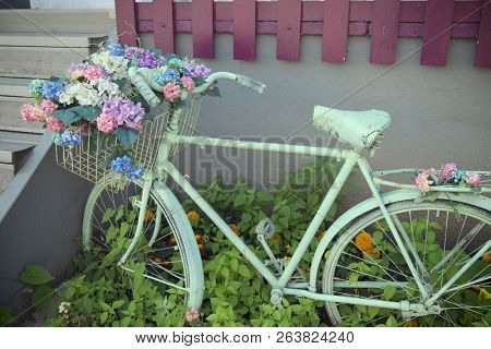 decorative retro bicycle with a bunch of flowers in the basket, Sarajevo - Bosnia And Herzegovina  poster