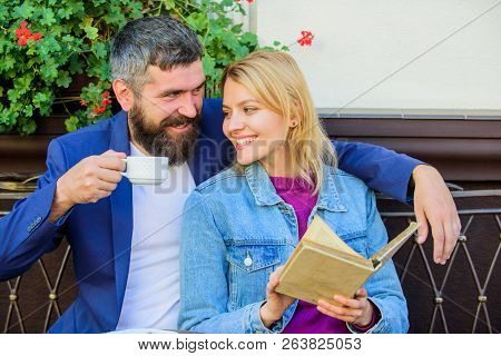 Couple In Love Sit Cafe Terrace. Man With Beard And Blonde Woman Cuddle On Romantic Date. Romance Co