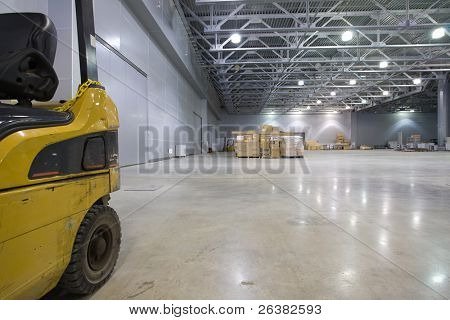 Loader in  large modern storehouse