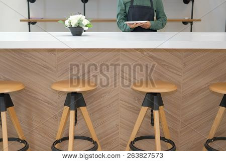 Business Owner Wearing Apron Holding Tablet At Counter Bar. Man Using Touchpad At Cafe Coffee Shop R