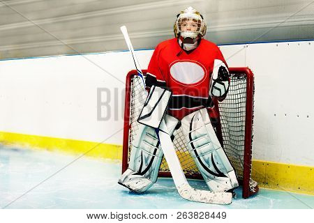 Young Goaltender Protecting Net During The Game