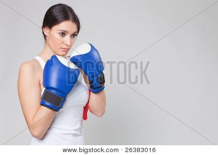 Portrait of young female pensive boxer