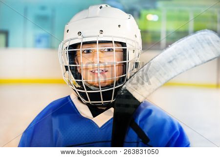 Happy Hockey Player Preparing To Go Out On The Ice