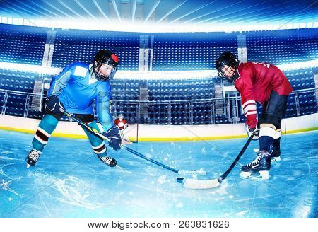 Hockey Opponents Challenging For Puck At Stadium