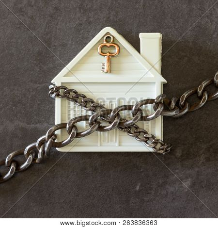 House In Chains. Concept  -  Risks, Lose Property,  Seize, Mortgage.