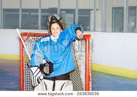 Happy Boy Goaltender Posing After Hockey Match