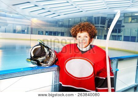 Happy Young Hockey Player Preparing To Hit The Ice
