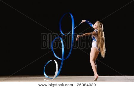 12 years old girl doing rhythmic gymnastics with ribbon